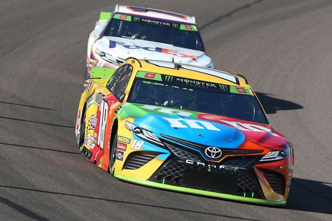 "<span id=""CT_Main_1_cache_lblCaption"">Kyle Busch, driver of the #18 M&amp;M's Toyota, leads Denny Hamlin, driver of the #11 FedEx Ground Toyota, during the Monster Energy NASCAR Cup Series Bluegreen Vacations 500 at ISM Raceway on November 10, 2019 in Avondale, Arizona. </span>"