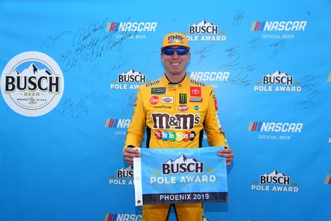 "<span id=""CT_Main_1_cache_lblCaption"">Kyle Busch, driver of the #18 M&amp;M's Toyota, poses with the pole award after qualifying for the Monster Energy NASCAR Cup Series Bluegreen Vacations 500 at ISM Raceway on November 09, 2019 in Avondale, Arizona</span>"
