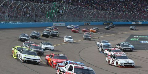 """<span id=""""CT_Main_1_cache_lblCaption"""">Christopher Bell, driver of the #20 Rheem Toyota, leads a pack of cars during the NASCAR Xfinity Series Desert Diamond Casino West Valley 200 at ISM Raceway on November 09, 2019 in Avondale, Arizona.</span>"""