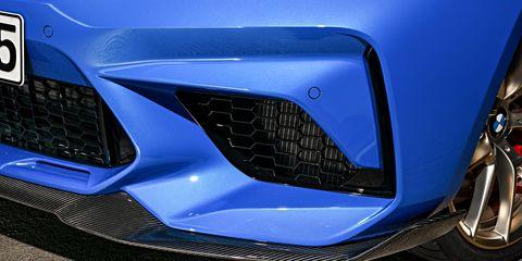 Land vehicle, Vehicle, Car, Automotive design, Blue, Automotive exterior, Grille, Automotive lighting, Electric blue, Bumper,