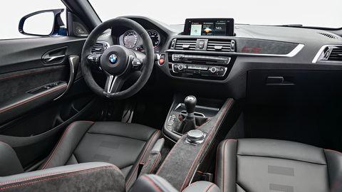 Land vehicle, Vehicle, Car, Personal luxury car, Center console, Luxury vehicle, Steering wheel, Automotive design, Gear shift, Bmw,