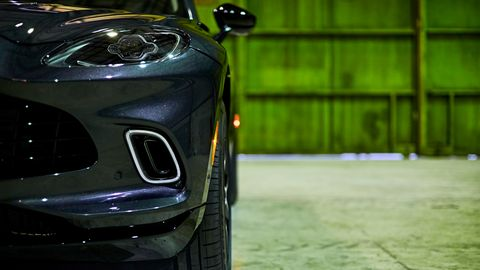 Daytime running lights flank the big grille on the Aston Martin DBX.