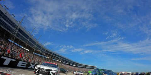 """<span id=""""CT_Main_1_cache_lblCaption"""">Kevin Harvick, driver of the #4 Busch Beer/Ducks Unlimited Ford, and Erik Jones, driver of the #20 Sport Clips Toyota, lead the field prior to the Monster Energy NASCAR Cup Series AAA Texas 500 at Texas Motor Speedway on November 03, 2019 in Fort Worth, Texas.</span>"""