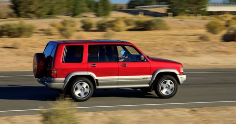 A quick glance doesn't reveal much. You might notice that the paint is a modern color—performance red pearl— but the overall impression is still very mid-1990s.