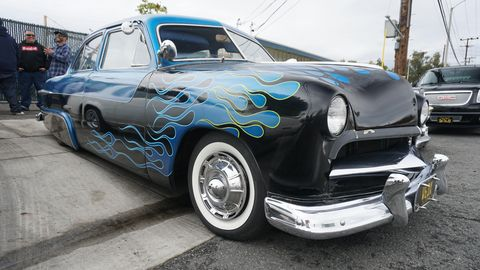 Mooneyes Xmas Show 'N' Shine returned to the shop for the first time in 16 years with lowriders, lead sleds and lots of flamin' good flames. Here's a flamin' blue custom 1950 Ford Tudor.