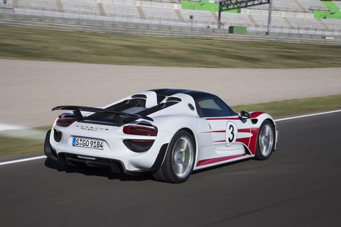 The Porsche 918 Spyder looks appropriate on a race track,with a racing number and livery.