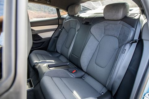 The rear seats of the 2020 Porsche Taycan 4S offer reasonable room. At 5 feet 11, I fit fine; if I sit perfectly straight, hair brushes the roof.