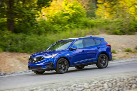 Our tester gets the A-Spec package, which pairs blacked-out exterior trim and 20-inch wheels with a sporty-looking interior. This RDX is shown in apex blue pearl (not fathom blue pearl as previously stated); ours is white.
