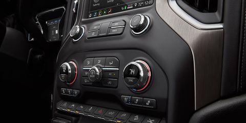 The 2019 GMC Sierra Denali gets an interior upgrade including premium leather seats, open-pore ash wood trim and dark-finish aluminum.