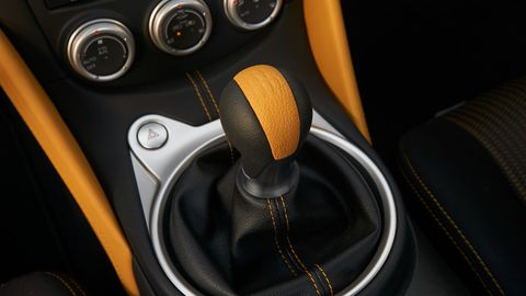 The 2018 Nissan 370Z Heritage Edition gets yellow accent stitching inside the cabin.