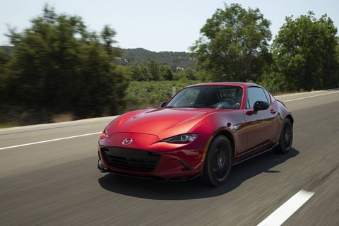 "MAZDA MX-5 Miata -- For 2019, the Mazda MX-5 Miata (RF model shown) got a new engine with considerably more power. Mazda bumped the MX-5's peak output by 26 hp for a total of 181. Torque nudges up 3 lb-ft to 151. Despite the extra oomph, the ""slow car fast"" mantra still fits. The MX-5's suspension setup happily remains the same. Upfront is a pair of double wishbones and in back is a multilink setup. It's still softly sprung, so the body leans into corners as lateral load builds. But adding power doesn't undermine the Miata's core mission of letting you drive the car to its limit, which is mercifully low enough to avoid a lasting jail sentence. It just feels right."