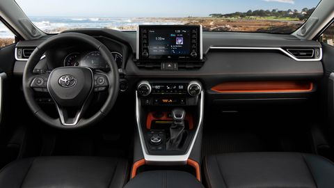 The 2019 Toyota RAV4 Adventure features orange accents inside, along with rubber trim on knobs and switches.