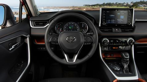 The 2019 Toyota Rav4 Adventure features orange accents inside along with rubber trim on knobs and switches.