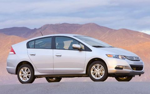 The Insight EX features with Vehicle Stability Assist, alloy wheels, cruise control; steering wheel-mounted paddle shifters; an upgraded audio system with six speakers and more