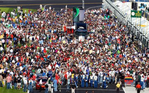 Fans swarm the grid prior to the start of the race.