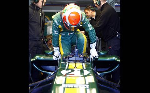 Jarno Trulli climbs into the new Lotus T128