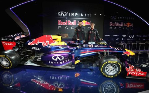 The Infiniti Red Bull Racing RB9 for 2013, along with drivers Mark Webber, left, and Sebastian Vettel.