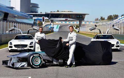 Lewis Hamilton, left, and Nico Rosberg take the wraps off the new Mercedes W04 Monday in Jerez, Spain.