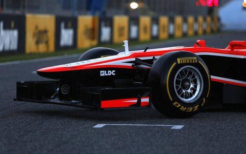 Tire, Wheel, Automotive tire, Automotive design, Open-wheel car, Formula one tyres, Formula one car, Formula one, Automotive wheel system, Red,