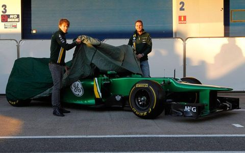 Drivers Charles Pic, left, and Guido Van Der Garde, Caterham F1, reveal the new Caterham CT03 Renault on Tuesday.