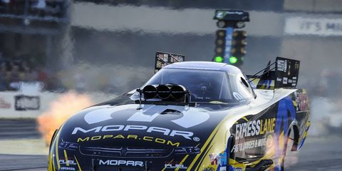 Matt Hagan set a track Funny Car record on his way to the top qualifying spot on Saturday.