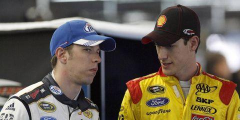 Howdy, partner: New Penske Racing teammates Joey Logano and Brad Keselowski get acquainted during NASCAR's Media Tour in Charlotte, N.C.