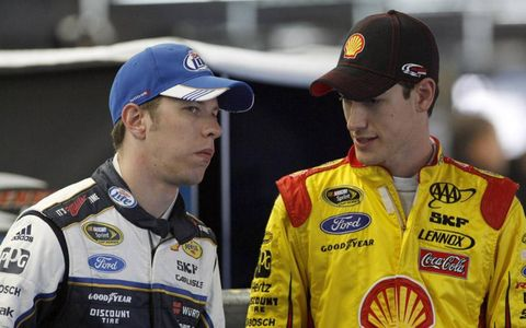 Howdy, partner: New Penske Racing teammates Joey Logano and Brad Keselowski get acquainted during NASCAR's Media Tour in Charlotte, N.C.