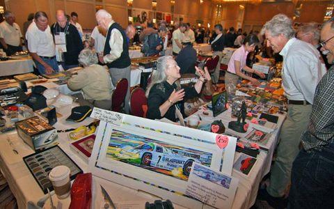 Susann Miller of Naples, FL hawks art, books, and badges at the LA Lit Meet.