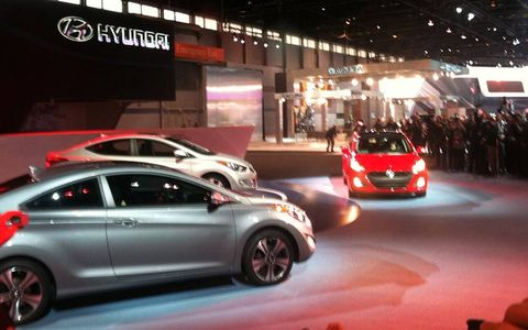 The Hyundai Elantra GT (in red) makes it's debut at the Chicago auto show.