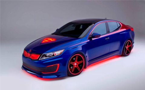 The Optima has been widened with custom fenders to give the sedan a muscular look.