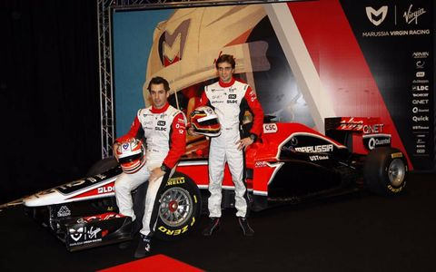 Timo Glock and Jerome d'Ambrosio stand next to the new MVR-02
