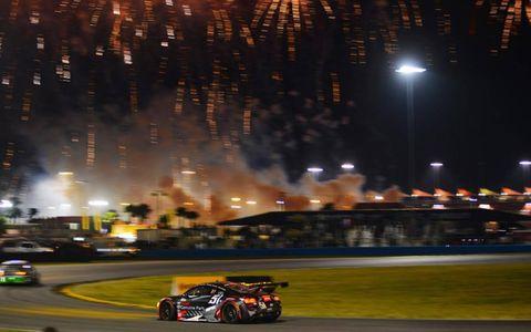 CUSTOMER SATISFACTION // The APR Motorsport Audi R8 laps under the fireworks at the 24 Hours of Daytona. Three of the company's cars finished in the top ten of the GT Class in the Grand-Am series opener.