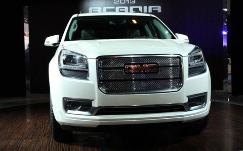 The 2013 GMC Acadia gets a redesigned grille.