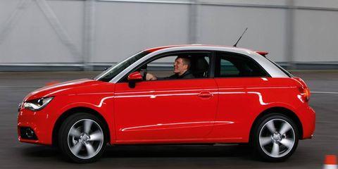 Tire, Wheel, Automotive design, Vehicle, Land vehicle, Car, Red, Alloy wheel, Rim, Vehicle door,