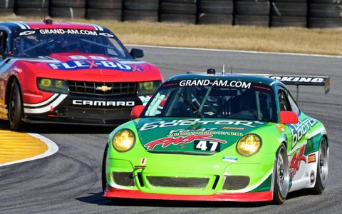 The #47 Porsche of Jeffrey Earnhardt, Scott Monroe, Doug Harrington, Maurice Hull, and Brett Sandberg leads another car.