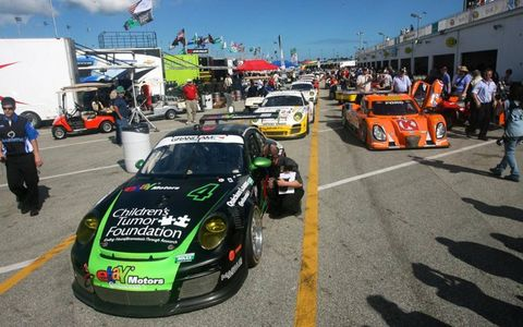 Start 'em up: Inside the paddock prior to practice for the Rolex 24 at Daytona.