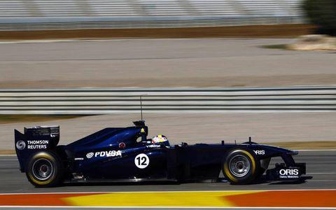 Tire, Wheel, Automotive tire, Automotive design, Vehicle, Open-wheel car, Automotive wheel system, Formula one tyres, Asphalt, Car,