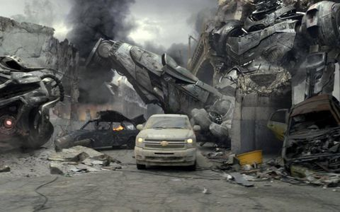 A Chevy Silverado pulls out from underneath rubble after the apocalypse in this Super Bowl ad, Ford later claimed the ads were dishonest.