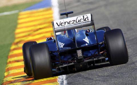 Tire, Wheel, Automotive tire, Open-wheel car, Automotive design, Formula one tyres, Automotive wheel system, Formula one car, Car, Formula one,