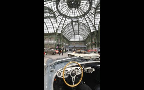 """PALAIS COUPE \\ This vintage car from Bonhams auction house helped mark the 110th anniversary of the Salon de l'Auto at the Grand Palais in Paris on Feb. 4. The exhibition, """"110 Years of Automobiles,"""" was followed by a sale of historic cars."""