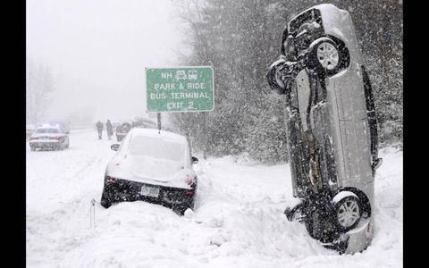 DOUBLE AXLE \\ No one was injured when this car landed vertically in a snow bank during a multicar accident on Feb. 1 on Interstate 93 near Salem, N.H.