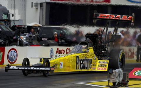 Spencer Massey brought home the first-place trophy in Top Fuel on Sunday.