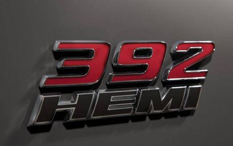 Side HEMI 392 badges display engine displacement of the 2013 Dodge Challenger SRT8 392.