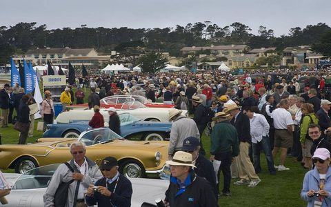 The large crowded filled the 18th hole at Pebble Beach on Sunday.