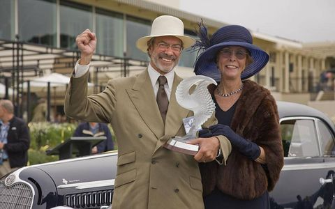 Jon and Mary Shirley hold the Best in Show trophy at Pebble Beach for their restored 1938 Alfa Romeo 8C 2900B Touring Berlinetta.
