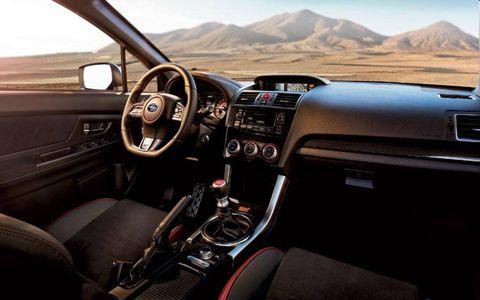 Interior shot of the 2015 Subaru WRX STI featuring the standard six-speed manual transmission.