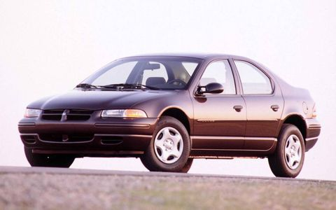 """Associate editor Angie Fisher's first car was a 1997 Dodge Stratus named """"Bessie"""" that was best known for her rusted back doors that wailed when opened."""