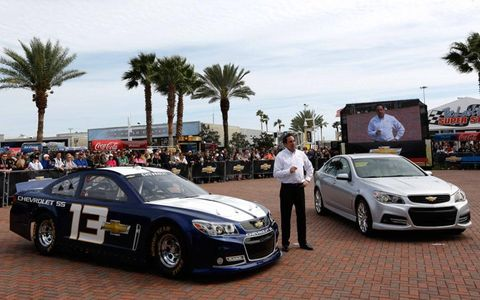 Mark Reuss, president of General Motors North America, shows off the production model Chevrolet SS, right, and the 2013 NASCAR Chevrolet SS on Saturday at Daytona International Speedway.