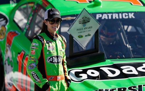 Danica Patrick poses with the trophy after becoming the first woman to win the pole for the Daytona 500.