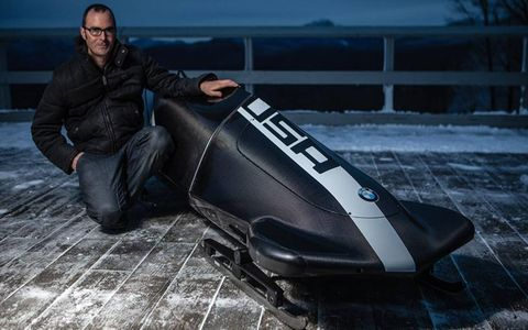 Michael Scully of BMW Designworks USA poses with the BMW bobsled.